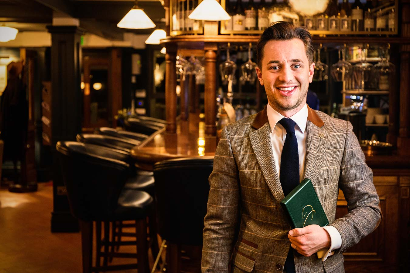 Environmental portrait of Daniel Crump, General Manager in the main restaurant of The Oxford Blue Pub, Windsor