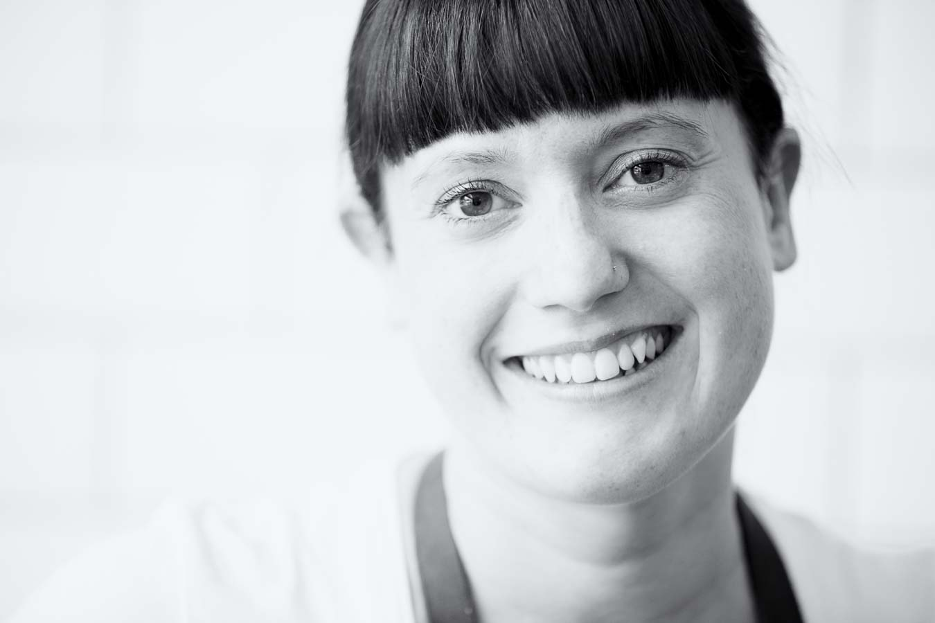 Natural light portrait of chef Kira Ghidoni smiling