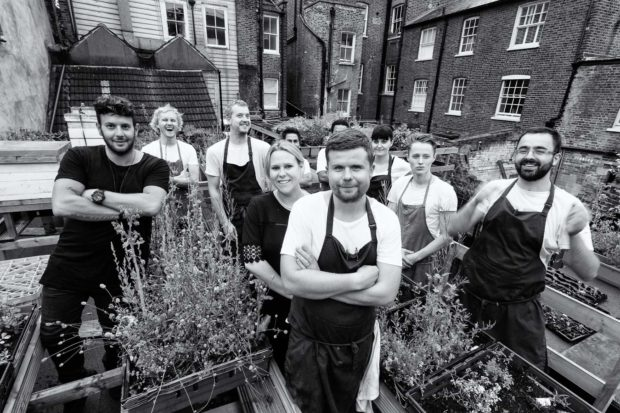 Group photo of chef Robin Gill and his team at The Dairy in the rooftop garden including Sarah Gill and Simon Woodrow