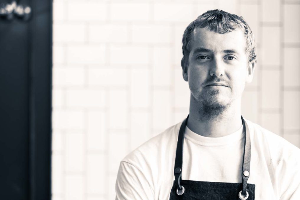 Black and white portrait of chef Simon Woodrow