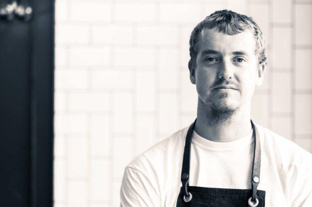 Black and white portrait of chef Simon Woodrow
