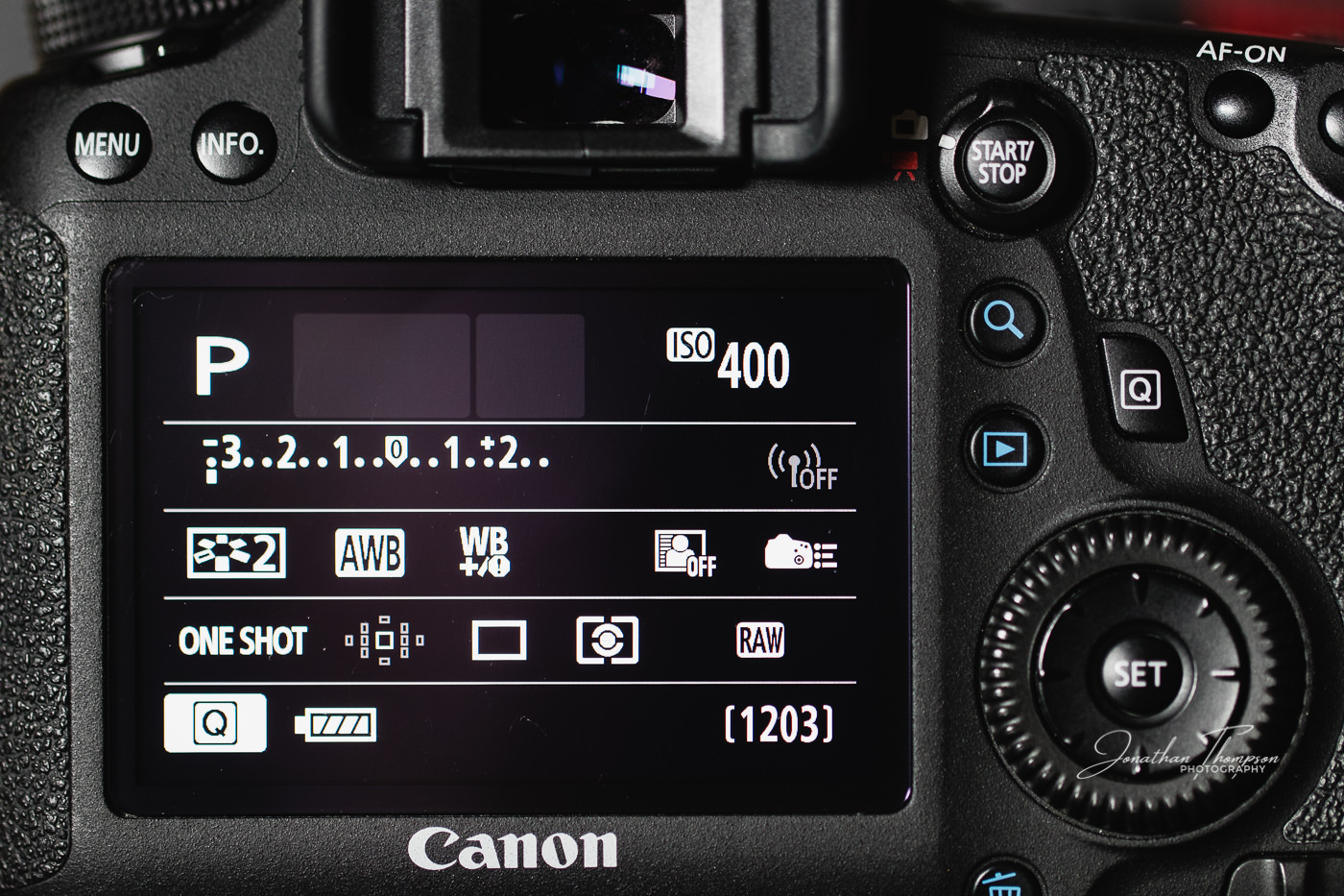 Canon DSLR rear screen displaying Program camera mode