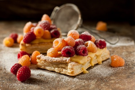 Puff pastry, creme pat tart with red and golden raspberries